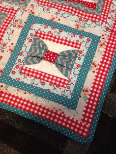Teal and red cherry blossom bow quilt. unfortunately there is no link to this quilt.