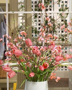 Spring Arrangement-pinks tulips and really like the quince for creating height
