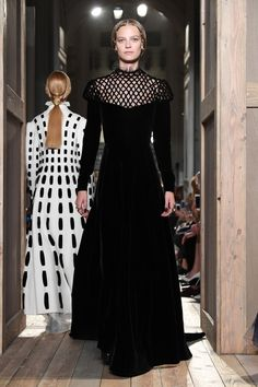 A model walks the runway during the Valentino Haute Couture Fall/Winter…