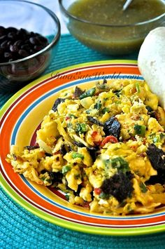 Migas (eggs, cheese, peppers, jalapeno, & crushed tortilla chips)