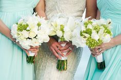 White flowers and aquamarine bridesmaids dresses make the perfect accents to a destination wedding on the beach at Secrets Akumal Riviera Maya! Photo courtesy of Jet Fete.