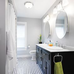 Redesigned contemporary bathroom  love the wall color and vanity