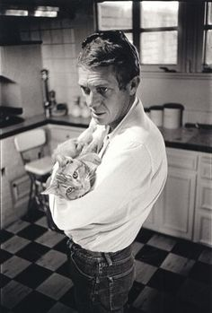"""Steve McQueen and his family cat,  """"Kitty Cat,"""" 1964"""