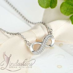 "Saying ""I Love you"" has never been this sparkling and beautiful. There is nothing more romantic than a gift of ""Infinite Glance"" necklace on your loved ones birthday, anniversary or any special occasion. Worn closely to the heart, this gleaming infinity sign pendant is the perfect way to tell someone you love them a lot. The contemporary twirl design will symbolize the eternal bond between two souls. Present it to make them smile on the big day…"