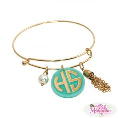 Fun flirty and full of personality This sassy little bracelet features a colorful acrylic disc with monogram to match the metal color The pearl and chai