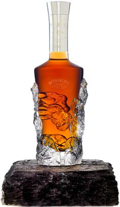 Bowmore Single Malt Scotch Whisky. Limited Edition, since 1969, Hand-crafted, 40 Years Old were ever created. Bowmore presented in an individually hand-blown and sculpted bottle, adorned with a hand-engraved solid silver neck collar.