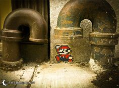 Mario tile pixel.  They should have painted the tubes bright green too.