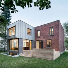 Steel cladding frames an offset window at  Montreal house extension by Naturehumaine