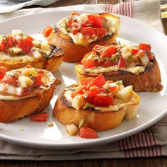 Bruschetta from the Grill Recipe -Dijon mustard, mayonnaise and oregano make a savory spread for chopped tomatoes, garlic and fresh basil in this fun twist on a favorite appetizer. This grilled bruschetta gets rave reviews every time I serve it. —Mary Nafis, Chino, California