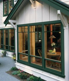 Coordinating Colors  + ADD TO MY PROJECT + SHARE + PRINT  Banks of Vinyl Single-Hung Windows (Premium) in Hartford Green with Top-Down grilles and energy efficient Low-E glass complement home's exterior trim creating a cohesive look throughout.  Products Shown: Premium Vinyl Single-Hung Window  Photo 7 of 8nextprevious