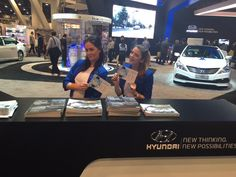 Hyundai was passing out these NFC brochures at CES helping drive exposure for their  BlueLink app. Tapping the brochure with any NFC device launches instant information