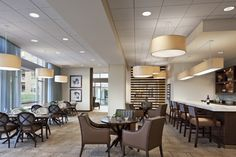 Perkins Eastman designed C.C. Young — The Overlook, an intergenerational independent living facility in Dallas, with several dynamic dining spaces, including this bar area (Photo copyright Chris Cooper, courtesy of Perkins Eastman)