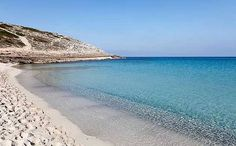 Cala Torta (Majorca) is not officially a nudist beach, so wear as much or as little as you like.