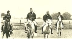 "United States Equestrian Team competing in Europe in the early 60s. Shown here from left to right is: Kathy Kusner, Bill Steinkraus, Frank Chapot and Carol Hoffman-Thompson. ""Notice all the horses in snaffles and the drop noseband on Carol's horse. The late great Dr. Reiner Klimke introduced me to this noseband during my dressage career it was one of his favorites."" ~Bernie Traurig"