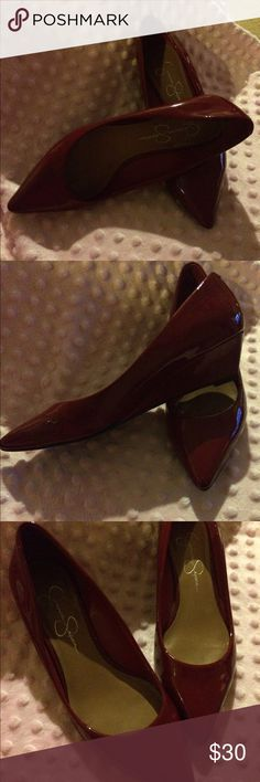 Jessica Simpson low cherry red wedges Jessica Simpson low cherry red wedges! Size 6...all my post pregnancy shoes are being sold :( my size 7 foot is happiness for your size 6 foot! Jessica Simpson Shoes Wedges