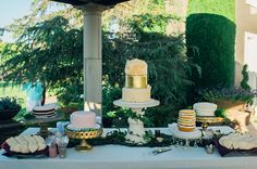 cake table - photo by Connection Photography http://ruffledblog.com/plum-and-gold-california-wedding