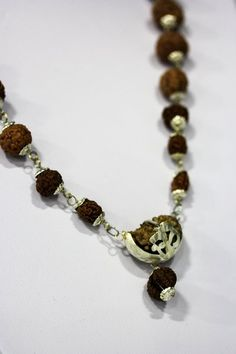 Authentic Rudraksha Mala with one faceted to 8 faceted rudraksha beads