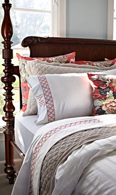 A crimson background showcases an exotic bird perched amid a burst of floral blooms in the Portobello Vase Pillow.