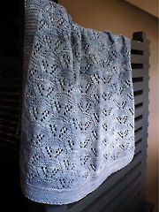 Cradle Me Blanket Knit Pattern from AnniesCatalog.com. Order here: https://www.anniescatalog.com/detail.html?prod_id=113077&cat_id=1025