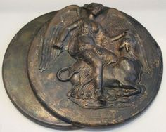 Mirror with a relief representation of goddess Nike, Victory slaying a Bull - circa 300-250 BC - at the Museum of Athens
