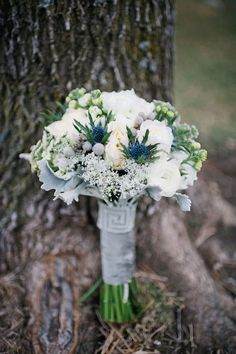 Winter bouquet of artemesia and Silver brunia, blue Thistle, rananculus, baby's breath, and stock. don't like the the baby's breath but love the blue thistle