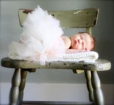 Newborn baby tutu classique perfectly proportioned. Soft ethereal tutu in classic ivory and nursery decoration.