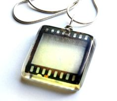 SO CUTE!!!! A slide would be cool! 35mm film negative pendant and necklace- hangs on 18 inch silver chain