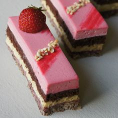 Delicious multi-layer entremet with strawberries, pistachios, hazelnuts and chocolate!