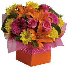 A47 - Starburst Splash. Joyful moments call for happy flowers! This box of blooms does the trick with orange lilies, pink roses, yellow daisies and hot pink gerberas.