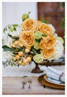 Garden rose and hydrangea centerpiece | floral arrangement by Rachel Mercier, photography by Tory Williams