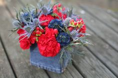 Fourth of July inspired floral centerpiece with denim wrapped vase