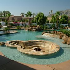 Wow...nothing like taking a dip in this glamorous pool and then relaxing in the island fire pit in the evening! True vacation spa!   www.franksglass.com