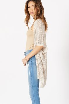 This pointelle poncho is exactly what your look needs to stand out from the crowd.