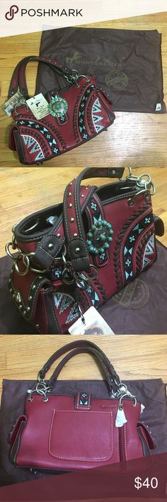 """Montana West conceal carry red and turquoise purse Selling one Montana West concealed carry purse. This purse has beautiful intricate embroidery on front as well as large silver and turquoise medallion. Interior of the purse has two open pockets on right side, Center zippered pocket, and zippered pocket on the left side. All is closed by one main zipper. The bag measures approximately 13"""" wide, 8"""" tall, and 4 1/2"""" deep. The strap drop is 10"""". Scratch on front mostly covered by medallion…"""