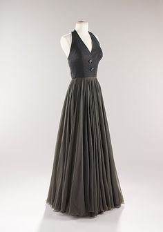 Evening ensemble  James Galanos (American, born Philadelphia, Pennsylvania, 1924)  Date: ca. 1954 Culture: American Medium: wool, silk Dimensions: Length at CB (a): 48 in. (121.9 cm) Length at CB (b): 20 in. (50.8 cm) Credit Line: Brooklyn Museum Costume Collection at The Metropolitan Museum of Art, Gift of the Brooklyn Museum, 2009; Gift of Betsy Pickering Theodoracopulos, 1966 Accession Number: 2009.300.418a, b