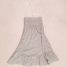 Victoria's Secret PINK Cover-up Victoria's Secret PINK swimsuit coverup (or can be worn as sundress!). Light gray and white stripes. Scrunchy, stretch material for bust (strapless) - has a white ribbon that can be tied around neck. Has two pockets. Frilly bottom allows it to be more of a casual sundress. Looks brand new! Victoria's Secret Swim Coverups