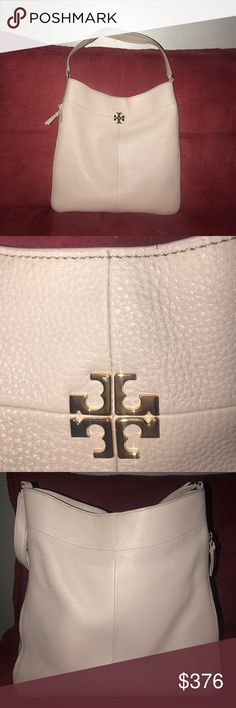 Tory burch hobo bag. NTW Tory butch hobo bag. It is a very feminine faded pink color. Zippers on the sides open up to make more space, and a fashion statement. Tory Burch Bags Hobos