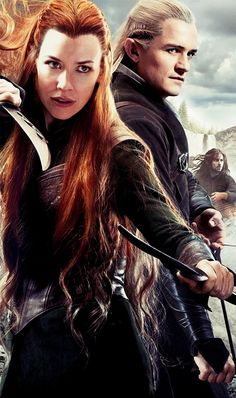 Oh my gosh I saw this picture and I was all like AW Tauriel and Legolas this is so great, and then for no reason I started laughing when I saw Kili in his barrel in the background.