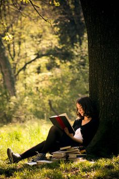 love reading! like how this picture looks like you have come across someone in the woods and they dont know you are watching them