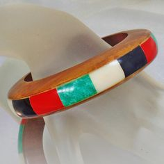 #Vintage Wood and Inlaid Dyed Bone Bracelet. Wood and Coral, Onyx, Mother of Pearl, Faux Jade Dyed Bone Bangle.  This vintage wood and inlaid dyed bone bracelet is absolutely incredible!  It features a substantial wood bracelet with inlaid stone or bone in shades of coral red, mother ... #etsy #vintage #antique #shopping #christmas #jewelry #jewellery