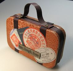 Suitcase made out of an Altoids tin. I don't even know what this would be used for, but it's adorable!