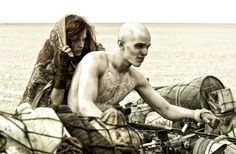 "A ride in the desert: Riley Keough as Capable and Nicholas Hoult as Nux in ""Mad Max: Fury Road."""
