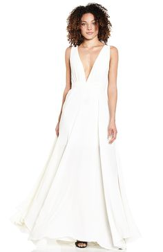 Sleeveless chiffon maxi gown featuring a plunging neckline with gathering at the bust, a pleated waistband, uneven hemline, mesh back and a partial lining with an invisible side zipper.