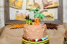 #dinosaur #birthday #party chocolate cake with chocolate frosting, perhaps? Yellow cake with chocolate frosting? Topped with plastic tree and dinosaur Niko already has. Candy rocks for the base (and top?) can be bought at Andy's Fruit Ranch.