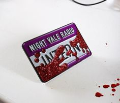 I NEED this welcome to night vale pin!