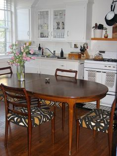 lovely African  (mud cloth?) fabric covered dining chairs in the kitchen of lisa mayock of Vena Cava