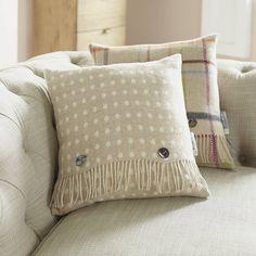 beige spot wool cushion by the wool room | notonthehighstreet.com