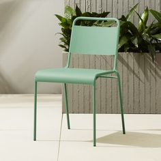 Shop lucinda mint stacking chair.   The café chair spiffs up in clean new lines and fresh new color.  Wide uni-slat back and generous seat with comfy waterfall at the knee shape up in modern matte mint, top to bottom.