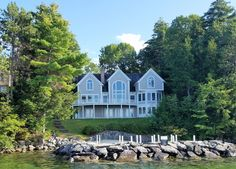 Come home to this beautiful, sprawling 12 room contemporary home on the shore of Lake Winnipesaukee. Reached by a winding drive through the woods, it feels private as soon as you turn off the main road.101 Andreson Drive, Alton, NH 03809