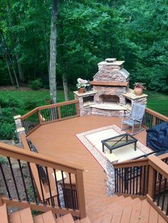 Stone outdoor fireplace and deck by Archadeck and stain by Renew Crew of Charlotte